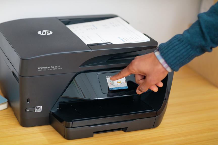 man using HP printer